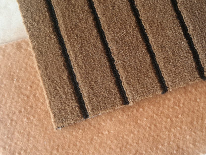 Carpet brake as anti-slip protection for carpets on smooth surfaces
